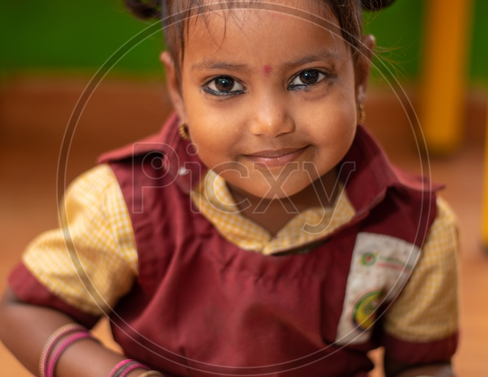 A girl student eating her mid day meal in an Anganwadi center
