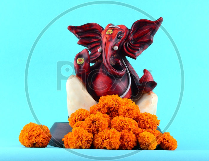 Hindu God Ganesha or Ganapathi. Lord Ganesha Idol on Blue Background