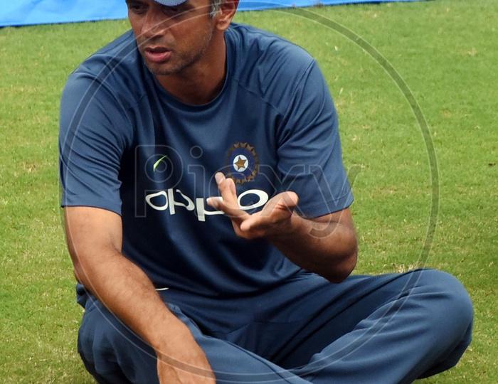 Rahul Dravid sitting on the ground