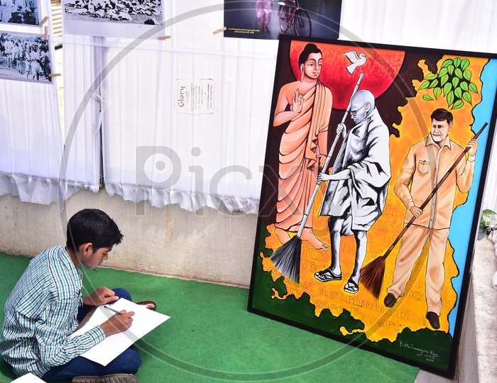 School kid drawing a sketch during a competition