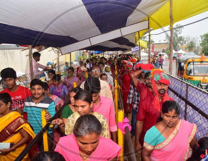 Devotees Carrying Mudupulu By wearing Bhavani Mala in Queue Lines