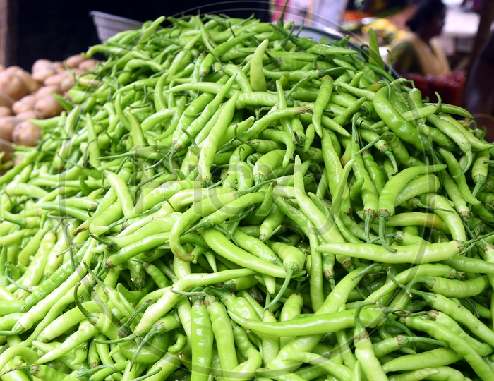 A pile of Green chillies in a vegetable market