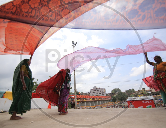 Indian women drying clothes in a ghat