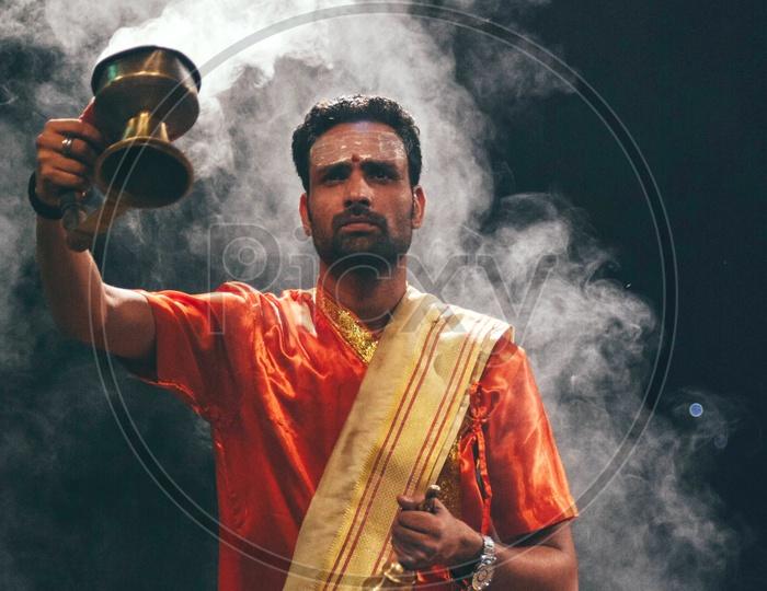 Priests Performing The Ganga Haarathi Or Aarthi