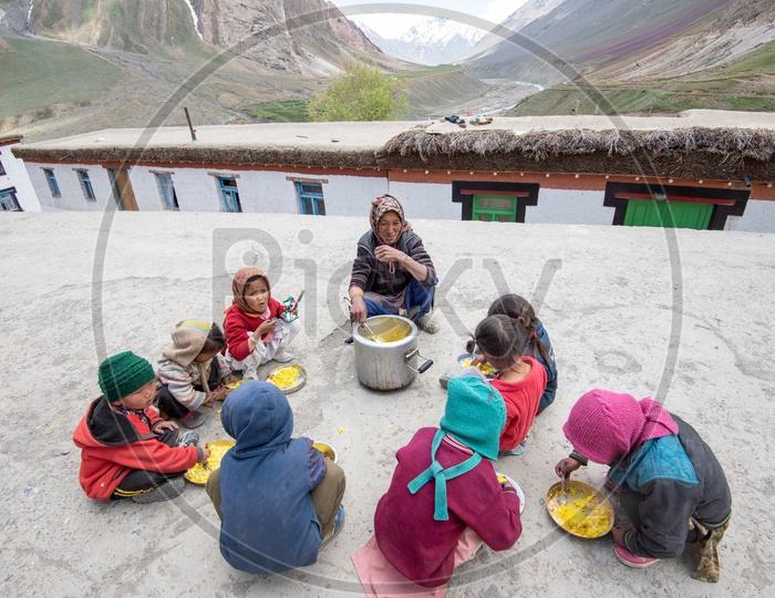 Children Having Their Meal at  School  in Leh
