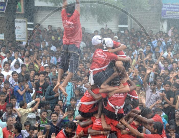 Crowd Of Young People Celebrating  'Govinda' at Dahi Handi Festival to celebrate God Krishna's  Birth in Amaravathi , Maharashtra