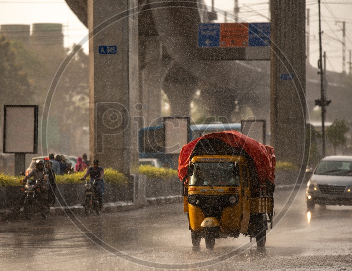 Truck Auto Or Goods Carrier Autos on Flooded City Roads in a Rainy Day