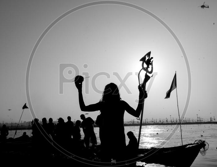 Silhouette Of Indian Naga Sadhus Or Babas Or Aghoras  at Kumbh Mela