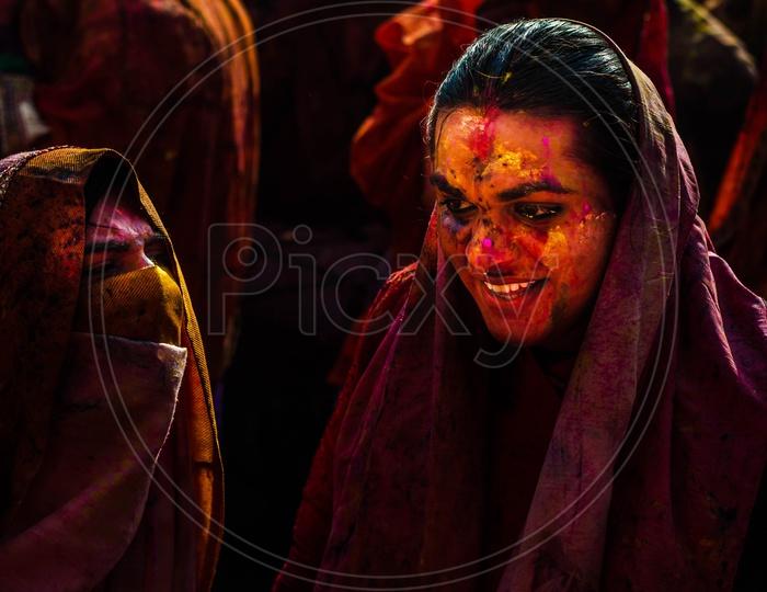 People celebrating Holi in Barsana