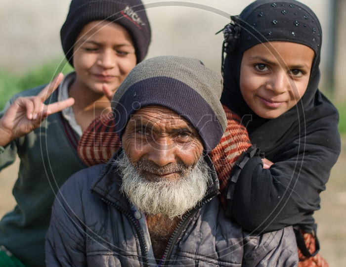 An Indian Grandfather With His Grand Children