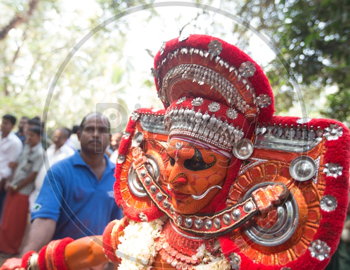 A Theyyam performer in colourful costume
