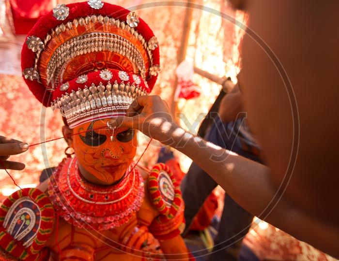 Theyyam artist getting ready for Theyyam Festival