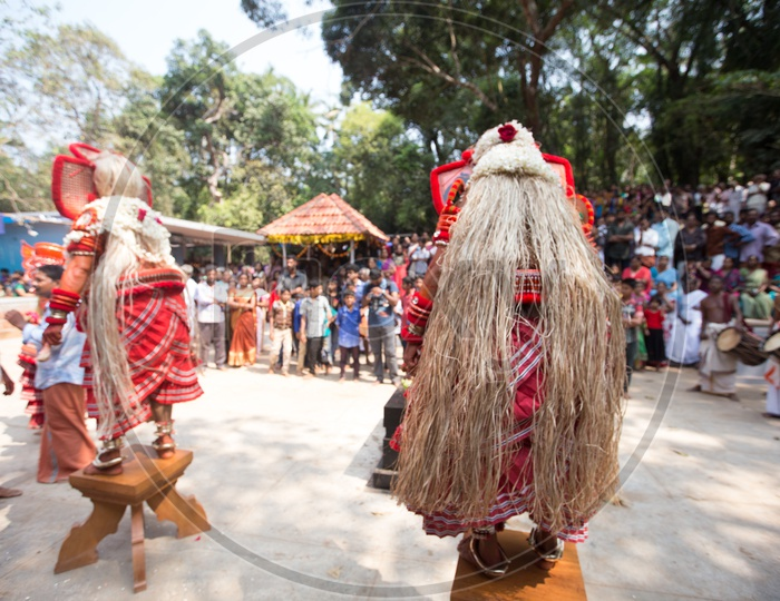 Artists during the performance of Theyyam