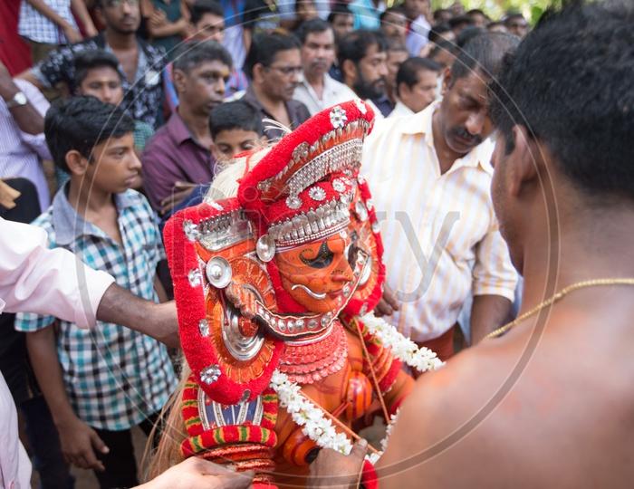 Artists Performing Theyyam , A Popular Ritual Dance Art Form  Of Kerala