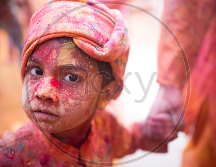 Child's face covered with Holi colors