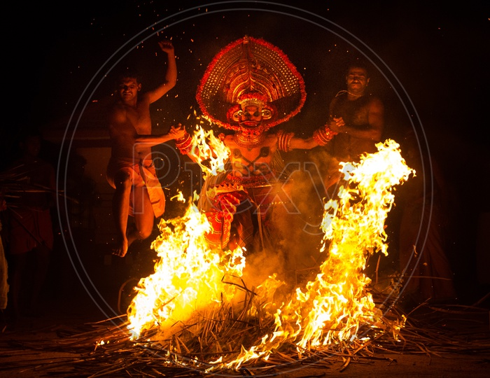 Artist performing Kalaripayattu during theyyam