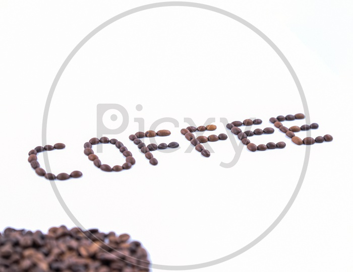 'Coffee' word made with coffee beans on white background