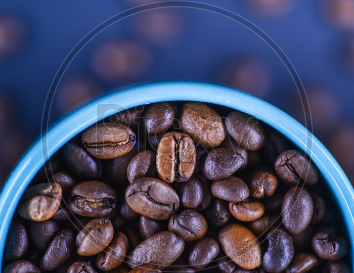 Composition Shot Of Coffee Beans In a Coffee Mug
