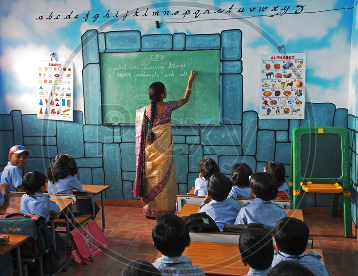 A Lady Teacher Teaching In a Classroom At  a Kids School