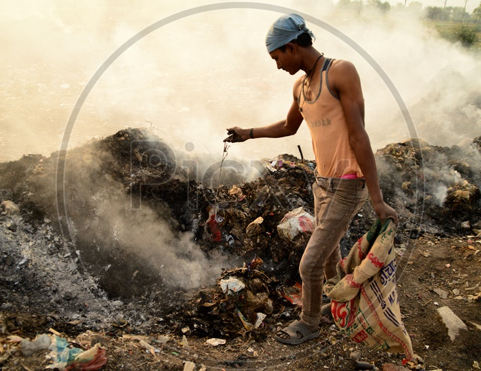 Unidentified Rag Pickers Collecting Recyclable Materials From Garbage Dump Yard