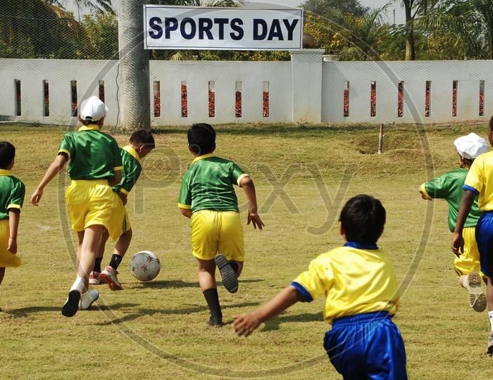 School kids playing football