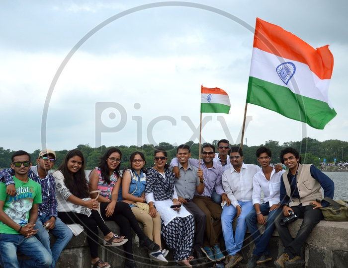 Young Indian People Waving  Indian National Flag ( Tri-Color ) Celebrating Independence Day