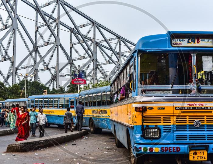 Howrah Bridge and the blue buses