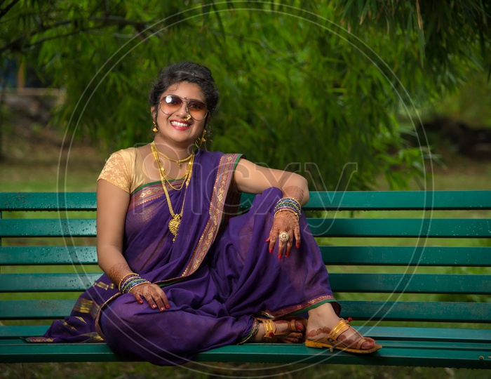 Indian traditional Beautiful Woman Wearing an traditional Saree And Posing On The Outdoor  With a Smile Face