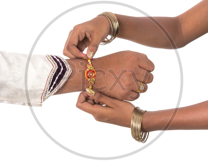 An Indian Man Or Brother Hand Tied With Elegant Rakhi  on The Rakhi Festival Occasion  On an Isolatted White Background