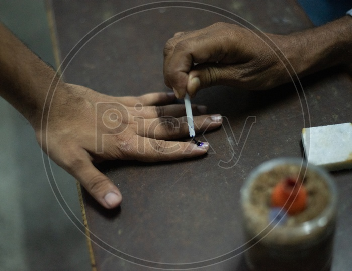 Voters Fingers Being Inked at a Polling Station at Polling Booths On Election Day