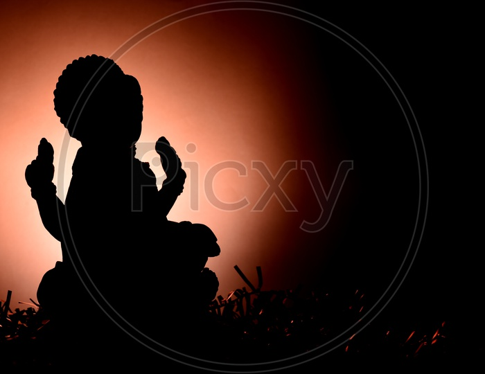 Silhouette Of Indian Hindu Goddess Lakshmi Idols During Diwali Festival Worships and Celebrations on an Isolated Background