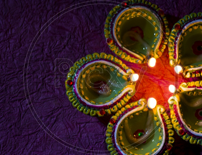Indian Lights Festival Diwali Clay Diya Lamps With A Led Light Bokeh Background For Diwali Greettings Templates