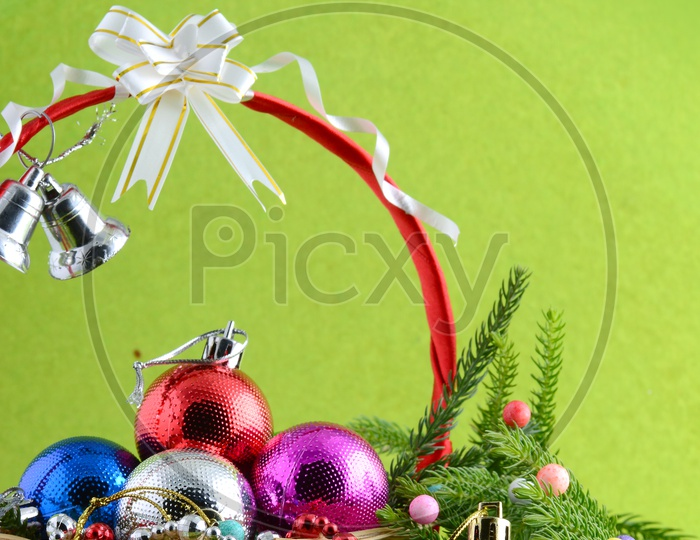 Christmas Decoration Balls With Christmas Tree Branch Forming a Background For Christmas Wishes