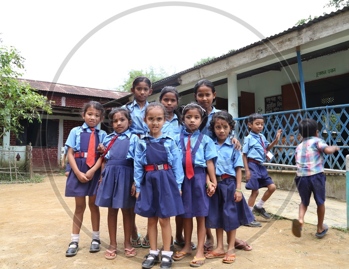 School Children Or School Students Wearing Uniforms  with Happily Smiling Faces   In a Rural Village School Premise Or Compound