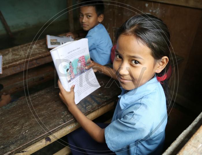 School Children  or School Students In a Classroom Wearing  School Uniforms With Books  in a Rural Village School