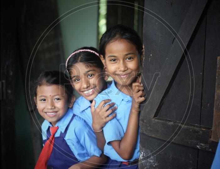 School Children Or School Students  Wearing Uniform  in a School Classroom With Books