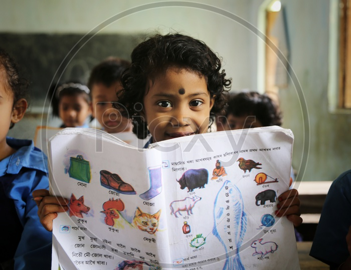 School Students or School Children in Uniforms  and In Classrooms  Reading Books  Or Listening To Classes
