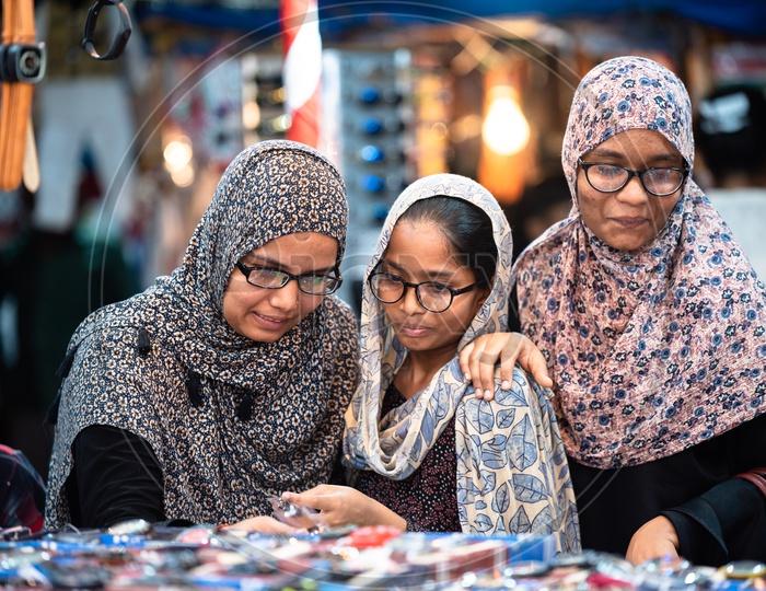 Muslim Women In Bhurkha   Shopping  Wrist Watches  in a  street stall Around Charminar  During  Ramadan or Ramzan Season