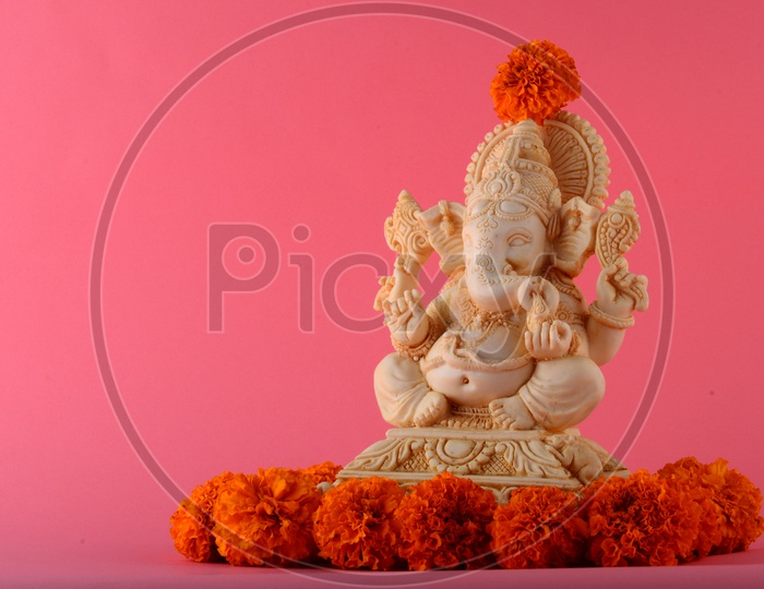 Indian Hindu God , Lord Ganesh Idol On an Isolated Background For Ganesh Festival Wishes or Greetings Template