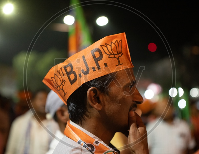 BJP Party Supporters Wearing The Party Caps At Election Campaign Rallies  Or At Party Meeting
