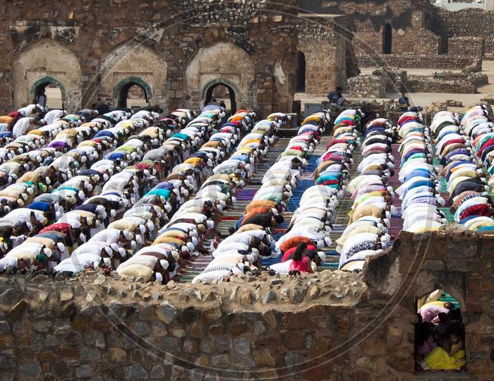 Muslims offering namaz prayer on Eid at Jami Masjid courtyard, Feroz Shah Kotla fort in Delhi