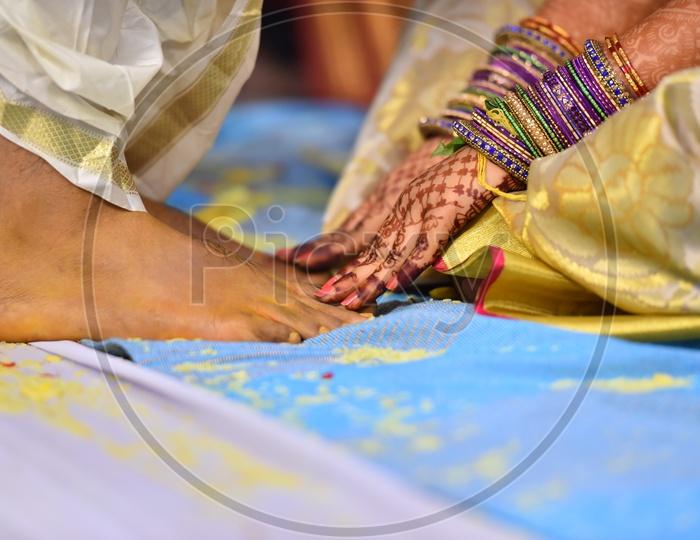 Bride Touching Bridegroom Feet As a tradition In  Telugu Wedding Or Marriage