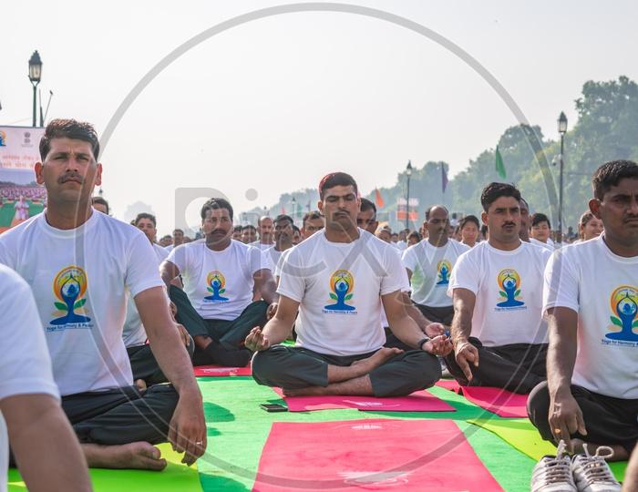 Men doing Kapalbhati Pranayama on International Day of Yoga at Rajpath, Delhi