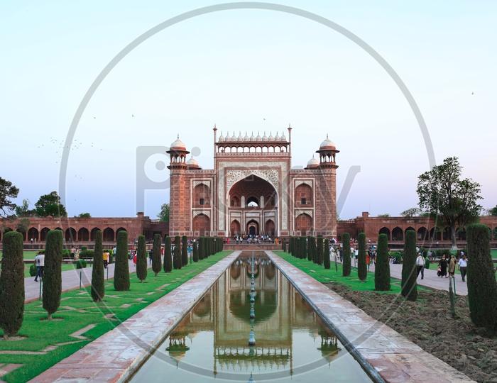 taj mahal entrance gate with reflection