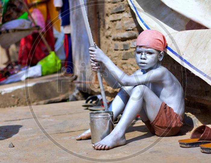 Small kid painted himself as Gandhi.
