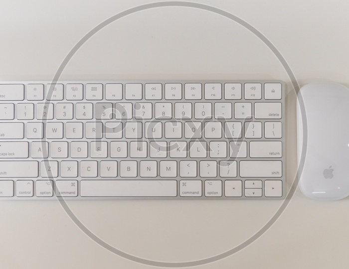 Top View Of Keyboard And Wireless Mouse  on a  Office Desk  Over a White Isolated Background