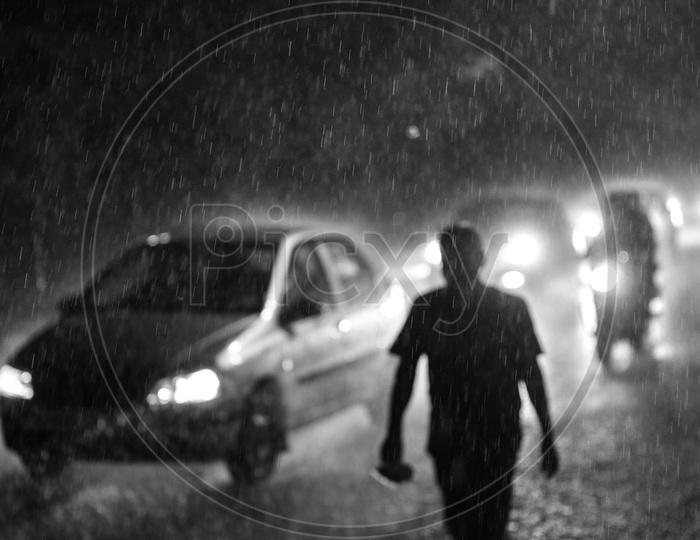 Drenching Commuting Vehicles in Monsoon Rains or Heavy Rain Fall On The urban City Roads