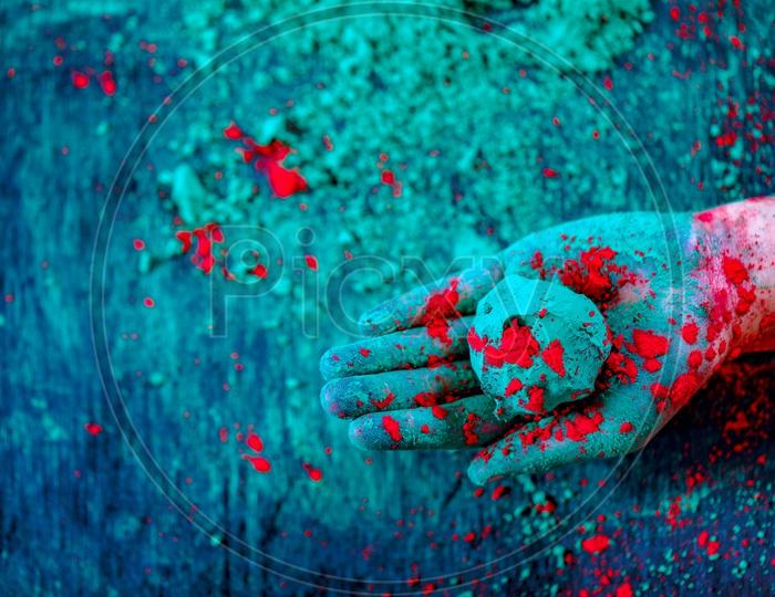 Holi Colour  Ball Or Holi Colour Bomb  Holding In Hand Closeup