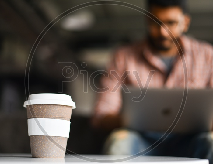 Coffee Mug Or Coffee Cup On a Working Working Mans Table