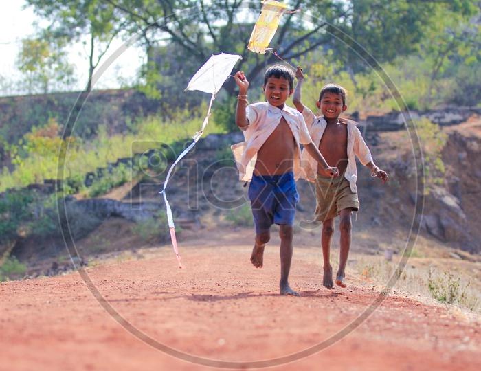 Indian Rural Village Kids or Children Playing With Kite